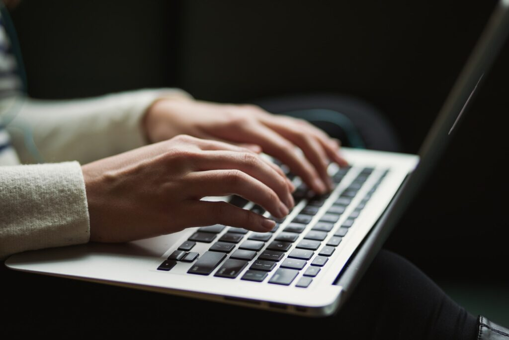 Someone Typing on a computer to show that blog marketing is an option