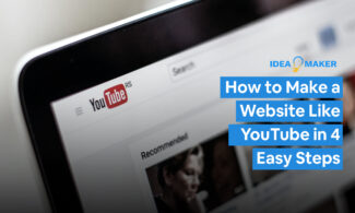 A computer screen on the YouTube Page with text: How to Make a Website Like YouTube in 4 Easy Steps