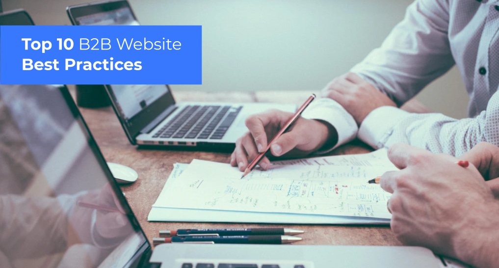 People looking at data with laptops with text: Top 10 B2B Website Best Practices