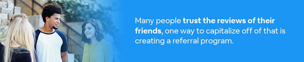 People talking on a street corner with text: Many people trust the reviews of their friends, one way to capitalize off of that is creating a referral program.