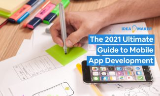A person using paper to plan out a mobile app with text: The 2021 Ultimate Guide to Mobile App Development