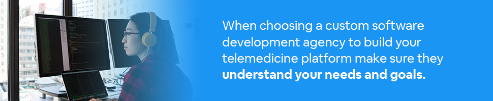 A developer looking at code on a computer screen with text: When choosing a custom software development agency to build your telemedicine platform make sure they understand your needs and goals.