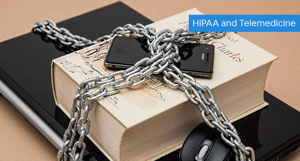 A laptop, book, and cellphone locked up by a chain with text: HIPAA and Telemedicine