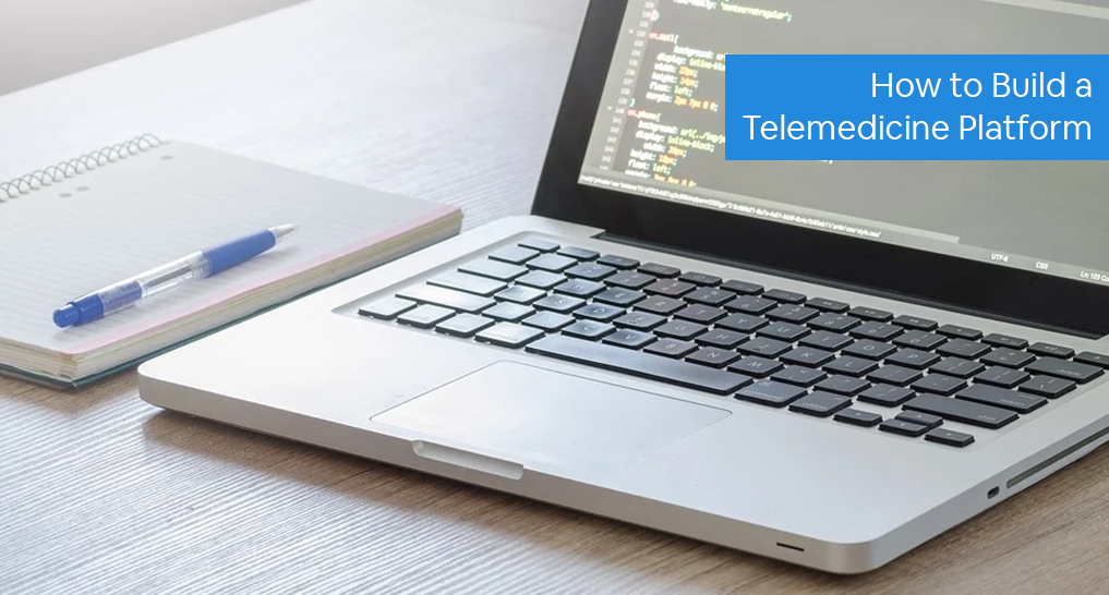 A laptop with code on it and a notebook with text: How to Build a Telemedicine platform