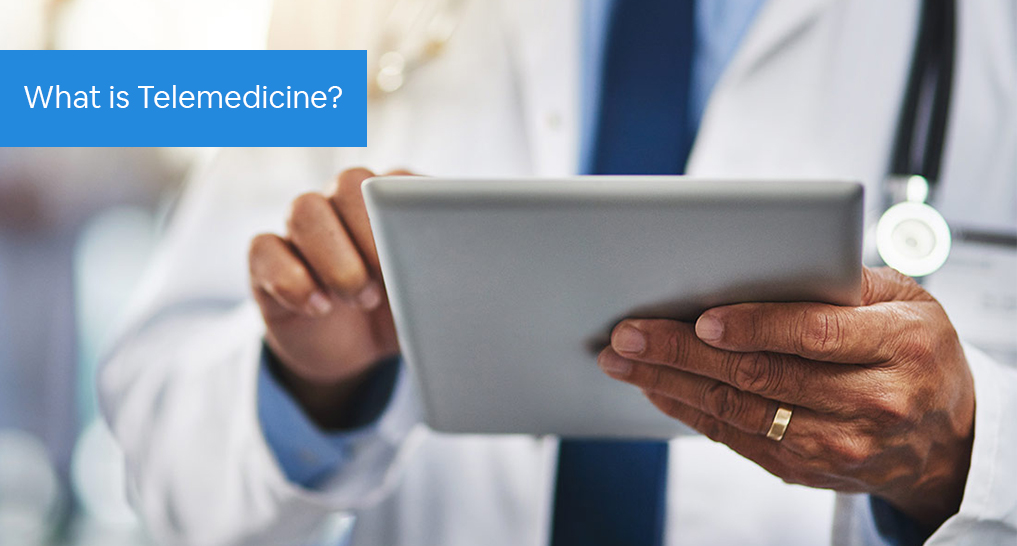A doctor on a tablet with text: What is Telemedicine