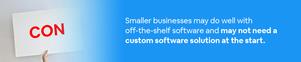 A hand holding up the word Con with text: Smaller businesses may do well with off-the-shelf software and may not need a custom software solution at the start.